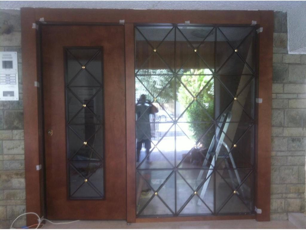 Νέα Σμύρνη πόρτα ασφαλείας είσοδος με σταθερό με κάγκελο χιαστί Δείτε έργα μας